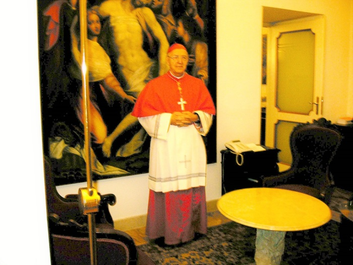 Cardinal Marchisano wearing rochet CAS presented him with